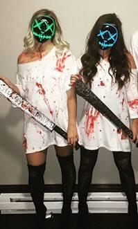 2 girls wearing led purge mask